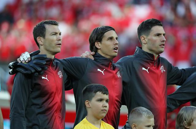 Soccer Football - World Cup - Group E - Serbia vs Switzerland - Kaliningrad Stadium, Kaliningrad, Russia - June 22, 2018 Switzerland's Stephan Lichtsteiner, Yann Sommer and Fabian Schar line up during the national anthems before the match REUTERS/Mariana Bazo