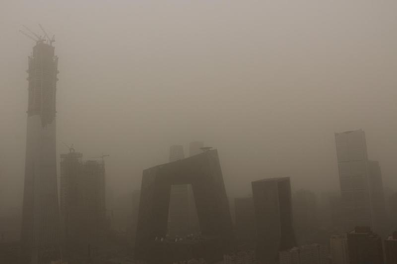 Beijing was shrouded in a murky yellow dust storm on Thursday: Reuters