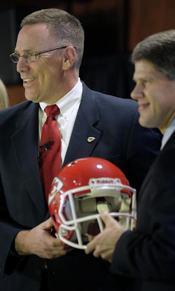 New Kansas City Chiefs general manager John Dorsey, left, poses with Chiefs' chairman Clark Hunt during an NFL football news conference Monday, Jan. 14, 2013, in Kansas City, Mo. (AP Photo/Charlie Riedel)