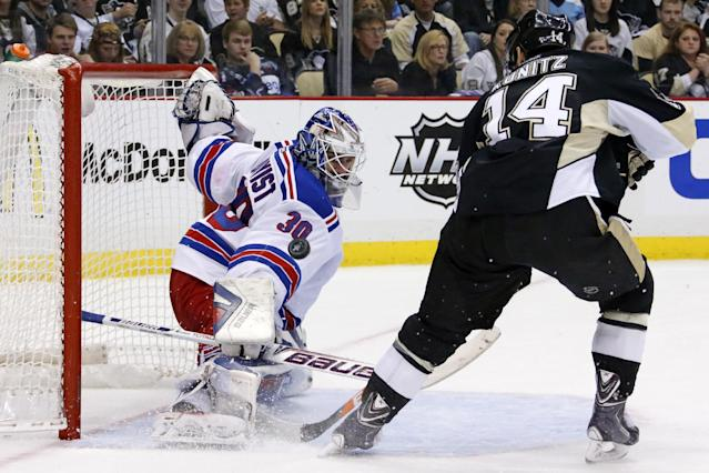 New York Rangers goalie Henrik Lundqvist (30) stops a shot by Pittsburgh Penguins' Chris Kunitz (14) in the second period of game 2 of a second-round NHL playoff hockey series in Pittsburgh Sunday, May 4, 2014. (AP Photo/Gene J. Puskar)