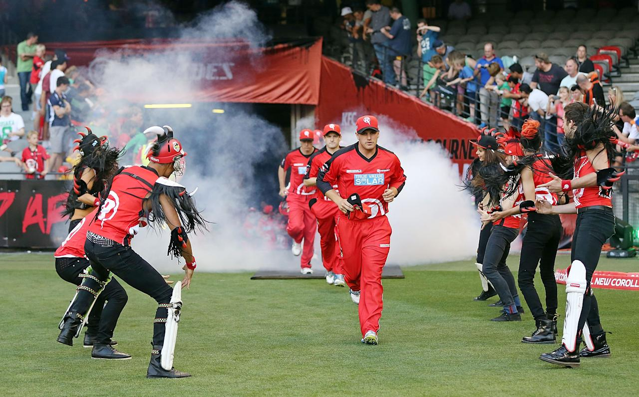 MELBOURNE, AUSTRALIA - DECEMBER 07:  Aaron Finch leads The Renegades out for the Big Bash League match between the Melbourne Renegades and the Melbourne Stars at Etihad Stadium on December 7, 2012 in Melbourne, Australia.  (Photo by Michael Dodge/Getty Images)