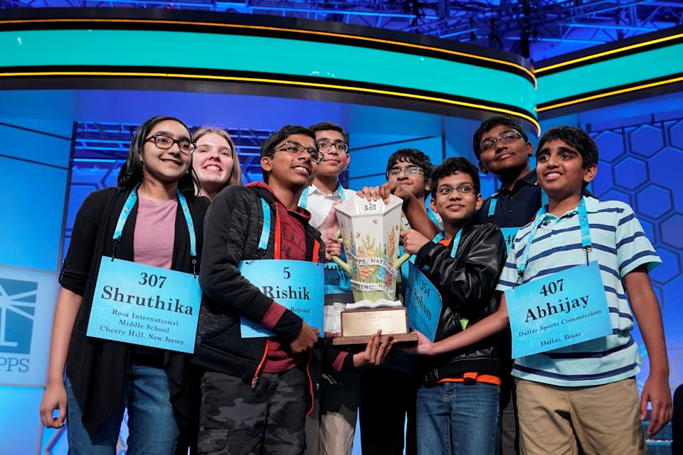 Shruthika Padhy, 13, of Cherryhill, New Jersey, Erin Howard, 14, of Huntsville, Alabama, Rishik Gandhasri, 13, of San Jose, California, Christopher Serrao, 13, of Whitehouse Station, New Jersey, Saketh Sundar, 13, Clarksville, Maryland, Sohum Sukhatankar, 13, of Dallas, Texas, Rohan Raja, 13, of Irving, Texas and Abhijay Kodali, 12, of Flower Mound, Texas celebrate their eight-way tie in the final round of the 92nd annual Scripps National Spelling Bee at National Harbor in Oxon Hill, Maryland, U.S., May 31, 2019.      REUTERS/Joshua Roberts     TPX IMAGES OF THE DAY