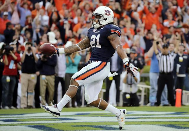 FILE - In this Nov. 16, 2013, file photo, Auburn running back Tre Mason (21) dances into the end zone after a touchdown run against Georgia during the first half of an NCAA college football game in Auburn, Ala. Mason is one of six finalist for the Heisman Trophy, which will be presented on Saturday, Dec. 14, 2013, in New York. (AP Photo/Dave Martin, File)