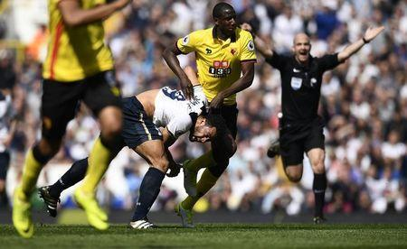 Britain Football Soccer - Tottenham Hotspur v Watford - Premier League - White Hart Lane - 8/4/17 Watford's Abdoulaye Doucoure in action with Tottenham's Mousa Dembele Reuters / Dylan Martinez Livepic