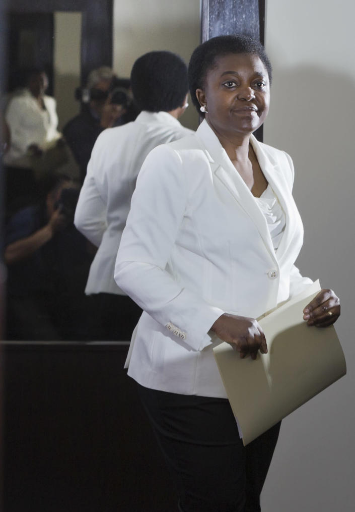Italian Integration Minister Cecile Kashetu Kyenge arrives at a press conference in Rome, Friday, May 3, 2013. The appointment of Italy's first black cabinet minister was initially hailed as a giant step forward for a country that has long been ill at ease with its increasing immigrant classes. Cecile Kyenge's new job has instead exposed Italy's ugly race problem, an issue that flares regularly on the football pitch with racist taunts and in the rhetoric of xenophobic political parties but has come to the fore anew as a shaky coalition government tries to bring Italy out of its economic doldrums. (AP Photo/Domenico Stinellis)