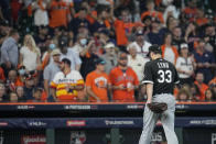 Chicago White Sox starting pitcher Lance Lynn heads to the dugout after being pulled from the game during the fourth inning in Game 1 of a baseball American League Division Series against the Houston Astros Thursday, Oct. 7, 2021, in Houston. (AP Photo/David J. Phillip)