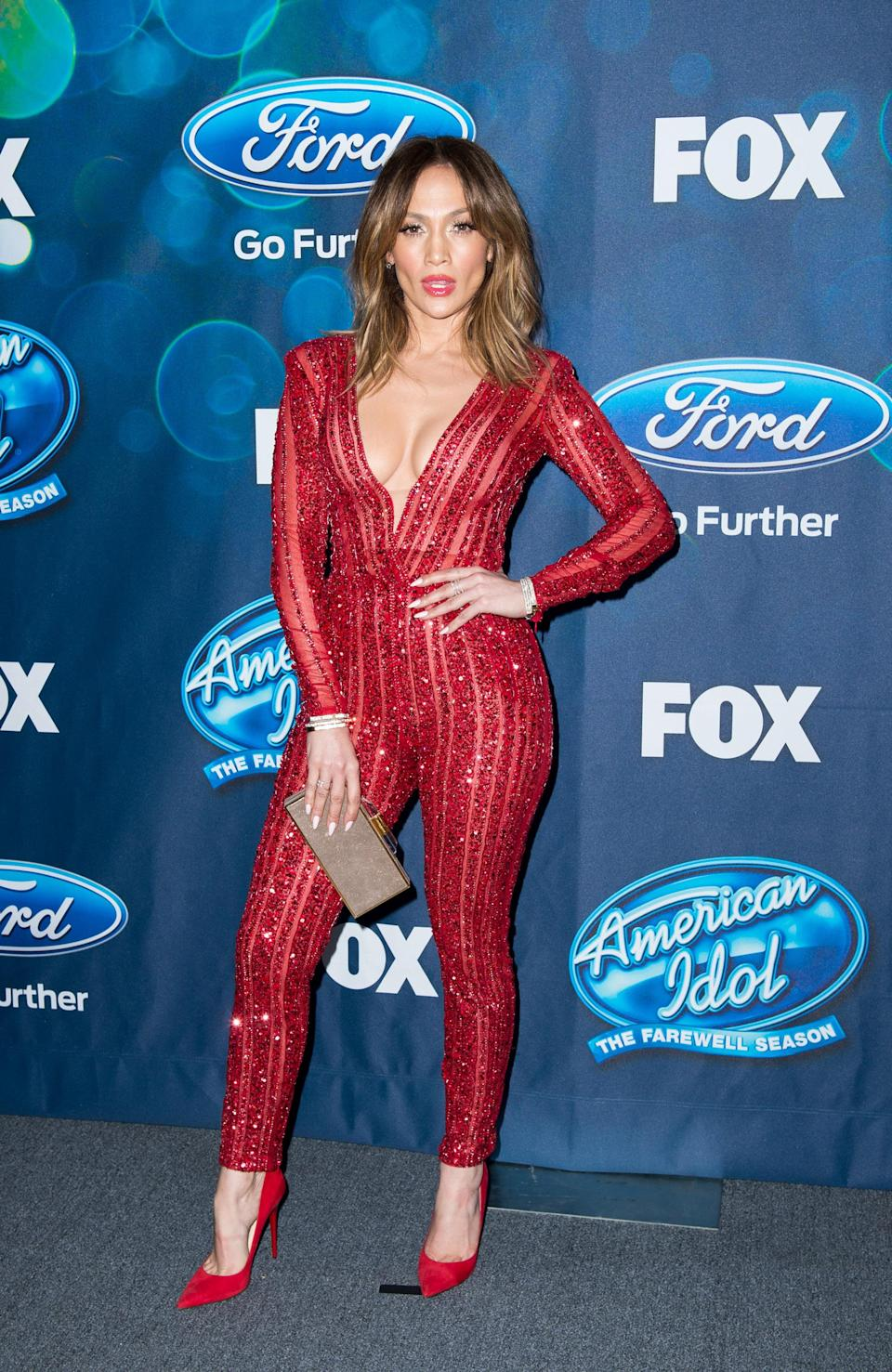 <p>2016 was the year J.Lo joined American Idol as a judge – it was also the year she donned this red sequins, pant suit look – and we are not worthy. [Photo: Getty] </p>