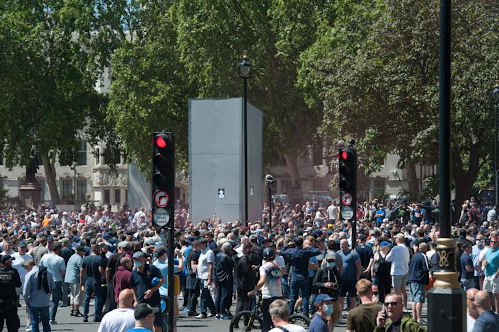 Protests at the boarded up Churchill statue in Parliament square on Saturday. (Getty)