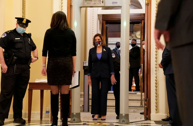 U.S. House Speaker Nancy Pelosi (D-CA) walks through a new metal detector outside the House chamber as the House prepares to vote on a resolution demanding Vice President Pence and the cabinet remove President Trump from office, at the U.S. Capitol