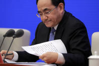 Xu Lin, Vice head of the Publicity Department of Communist Party looks at his notes during a press conference on the white paper on fighting COVID-19 China in action, at the State Council Information Office in Beijing, Sunday, June 7, 2020. Senior Chinese health officials defended their country's response to the new coronavirus pandemic, saying they provided information in a timely and transparent manner. (AP Photo/Andy Wong)
