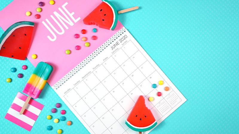 On-trend 2020 calendar page for the month of June modern flat lay with seasonal food, candy and colorful decorations in popular pastel colors. Copy space. One of a series for 12 months of the year.