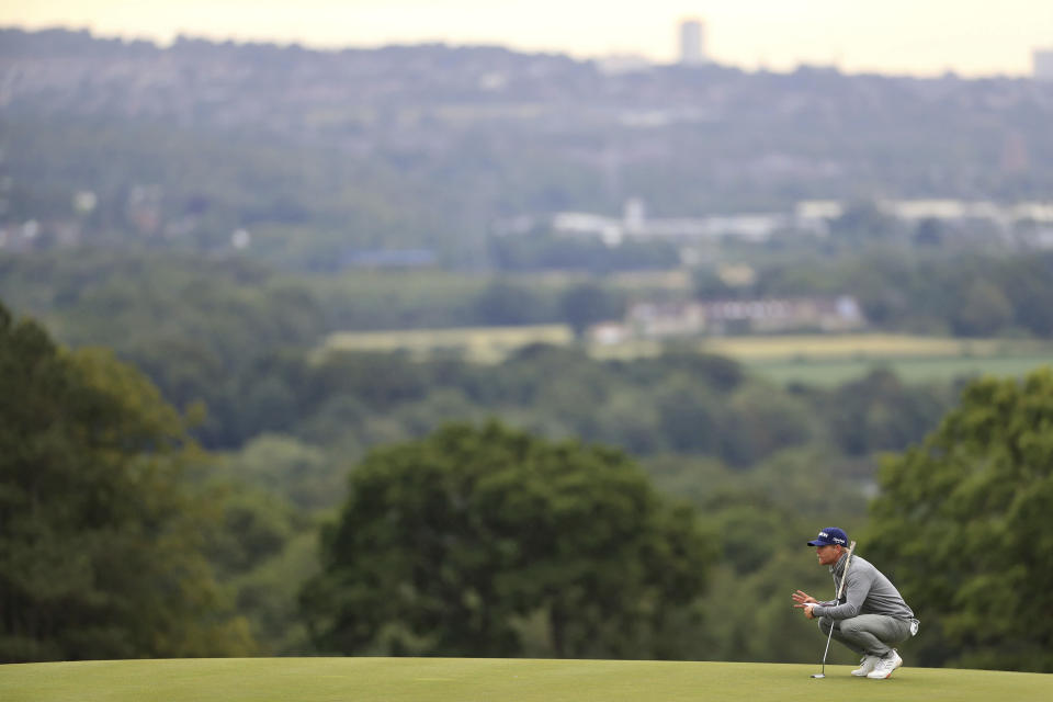 Zimbabwe's Scott Vincent lines up a putt during day one of the British Masters at Close House Golf Club, near Newcastle, England, Wednesday July 22, 2020. The European Tour resumes in earnest after its pandemic-induced shutdown with the British Masters starting Wednesday. (Mike Egerton/PA via AP)