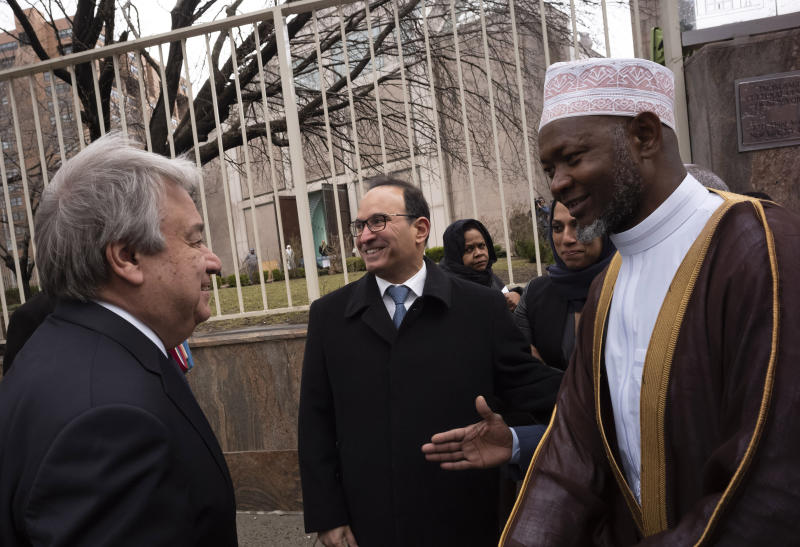 United Nations Secretary General Antonio Guterres, left, is greeted by Sheik Saad Jalloh, imam of the Islamic Cultural Center of New York, as he arrives for a service, Friday, March 22, 2019 in the wake of a white supremacist's deadly shooting spree on two mosques, March 15, in Christchurch, New Zealand. (AP Photo/Mark Lennihan)