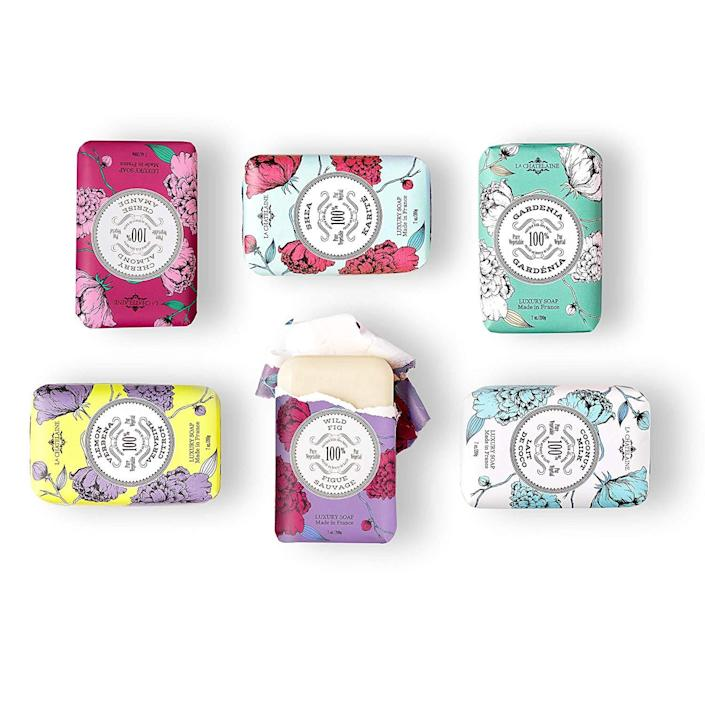 """<h2><a href=""""https://amzn.to/2VkyiC2"""" rel=""""nofollow noopener"""" target=""""_blank"""" data-ylk=""""slk:La Chatelaine Luxury Soap Collection"""" class=""""link rapid-noclick-resp"""">La Chatelaine Luxury Soap Collection<br></a></h2><br>When your gift selection is Oprah-approved, you know you can't go wrong. These plant-based soaps are made in France and packaged in a seasonal gift tin that any recipient would appreciate. <br><br><strong>La Chatelaine</strong> Luxury Soap Collection, $, available at <a href=""""https://amzn.to/2VkyiC2"""" rel=""""nofollow noopener"""" target=""""_blank"""" data-ylk=""""slk:Amazon"""" class=""""link rapid-noclick-resp"""">Amazon</a>"""