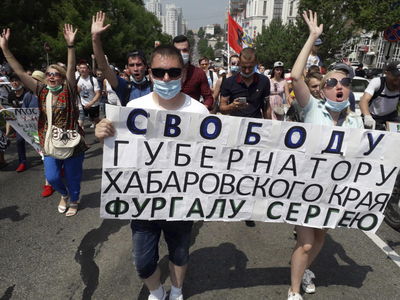"""People hold posters reading """"Freedom for Khabarovsk area's governor Sergei Furgal"""" throughout an unsanctioned protest in help of Furgal, who was interrogated ordered held in jail for 2 months, in Khabarovsk, 6,100 kilometers (3,800 miles) east of Moscow, Russia, Saturday, July 18, 2020. Thousands of demonstrators within the Russian Far East city of Khabarovsk collect to protest in opposition to the arrest of the area's governor on expenses of involvement in a number of murders. (AP Photo/Igor Volkov)"""