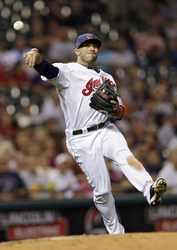 Cleveland Indians third baseman Mike Aviles throws to first base to get Houston Astros' Brandon Laird on a ground-out in the seventh inning of a baseball game on Friday, Sept. 20, 2013, in Cleveland. (AP Photo/Mark Duncan)