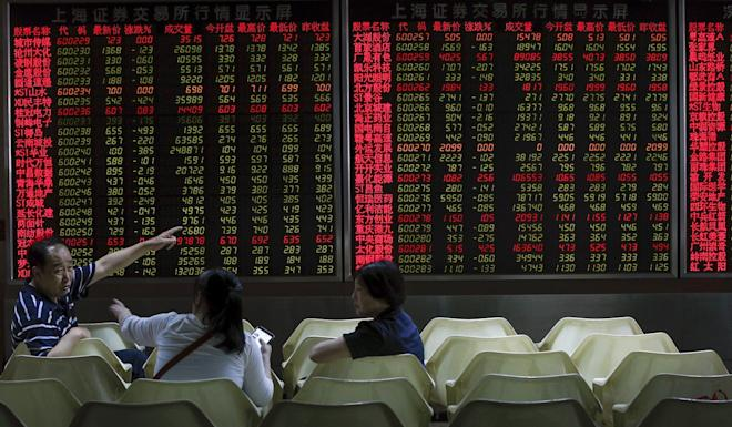 Investors monitor stock prices at a brokerage house in Beijing. The inclusion of Chinese A-shares in MSCI indexes has been a years-long process. Photo: AP