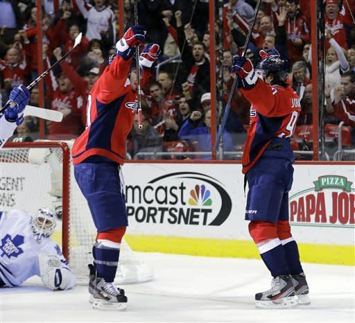Washington Capitals right wing Troy Brouwer, left, celebrates with center Marcus Johansson (90), from Sweden, after Johansson's goal against Toronto Maple Leafs goalie Ben Scrivens in the first period of an NHL hockey game Tuesday, Feb. 5, 2013, in Washington. (AP Photo/Alex Brandon)