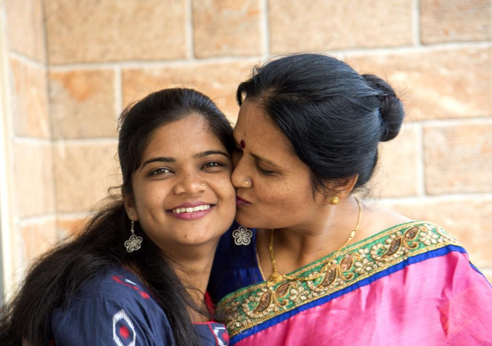 Indian mother and daughter embracing