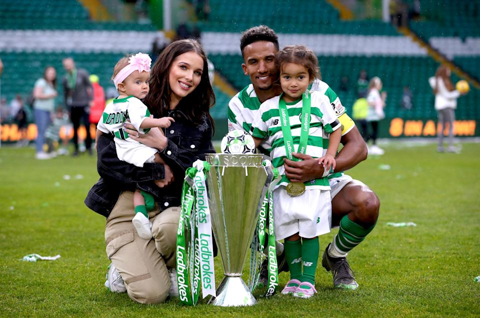 Celtic's Scott Sinclair, Helen Flanagan and their children with the trophy after winning the Ladbrokes Scottish Premiership match at Celtic Park, Glasgow. (Photo by Jane Barlow/PA Images via Getty Images)