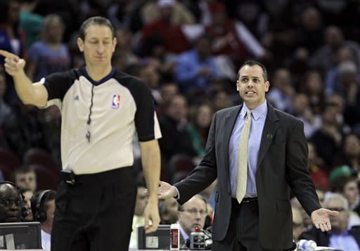 Indiana Pacers coach Frank Vogel complains about a call to referee Greg Willard in overtime during an NBA basketball game against the Cleveland Cavaliers on Wednesday, April 11, 2012, in Cleveland. The Pacers won 104-98. (AP Photo/Mark Duncan)