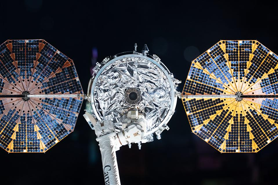 Northrop Grumman's Cygnus NG-13 cargo resupply spacecraft, with its shiny, cymbal-shaped solar arrays, is pictured in the grasp of the Canadarm2 robot arm on the International Space Station just before the vessel's departure on Monday (May 11). The NG-13 cargo ship, which delivered 7,500 lbs. (3,400 kilograms) of supplies for the station's three-person Expedition 62 crew in February, will spend the next few weeks flying solo in orbit, deploying tiny satellites and conducting a fire experiment. It will fall back to Earth on May 29 and safely burn up in our planet's atmosphere above the Pacific Ocean.