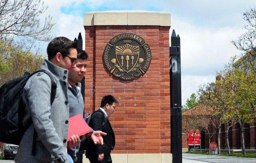 Students walk past an entrance to the University of Southern California (USC) in Los Angeles on April 11, 2012 in California. Two Chinese graduate students from the university were killed in an overnight shooting, which police suspect could have been a failed carjacking in an area southwest of downtown Los Angeles