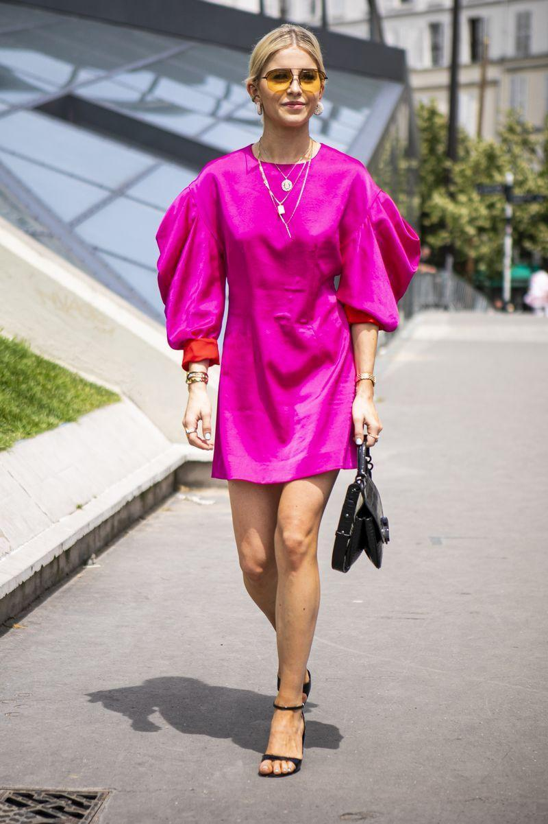 """<p>When it's hot outside, a <a href=""""https://www.cosmopolitan.com/uk/fashion/style/g10000448/best-summer-dresses/"""" rel=""""nofollow noopener"""" target=""""_blank"""" data-ylk=""""slk:summer dress"""" class=""""link rapid-noclick-resp"""">summer dress</a> is the first thing you want to reach for. And there's a simple way to take your fave minis to the office. Simply grab your looser fitted pieces and team them with dainty jewellery and your favourite top handle bag.</p>"""