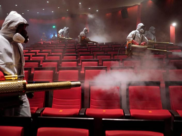 Volunteers from the Blue Sky Rescue team disinfect at the Qintai Grand Theatre in Wuhan on April 2, 2020.