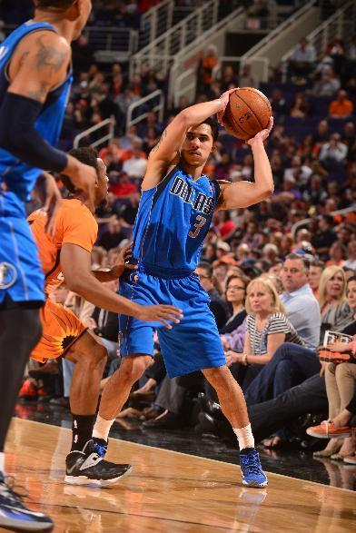 PHOENIX, AZ - JANUARY 17: Shane Larkin #3 of the Dallas Mavericks controls the ball against Ish Smith #3 of the Phoenix Suns on January 17, 2014 at U.S. Airways Center in Phoenix, Arizona. (Photo by Barry Gossage/NBAE via Getty Images)