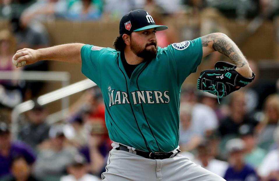 Seattle Mariners relief pitcher Rob Whalen throws against the Colorado Rockies during the first inning of a spring training baseball game in Scottsdale, Ariz., Tuesday, March 13, 2018. (AP Photo/Chris Carlson)