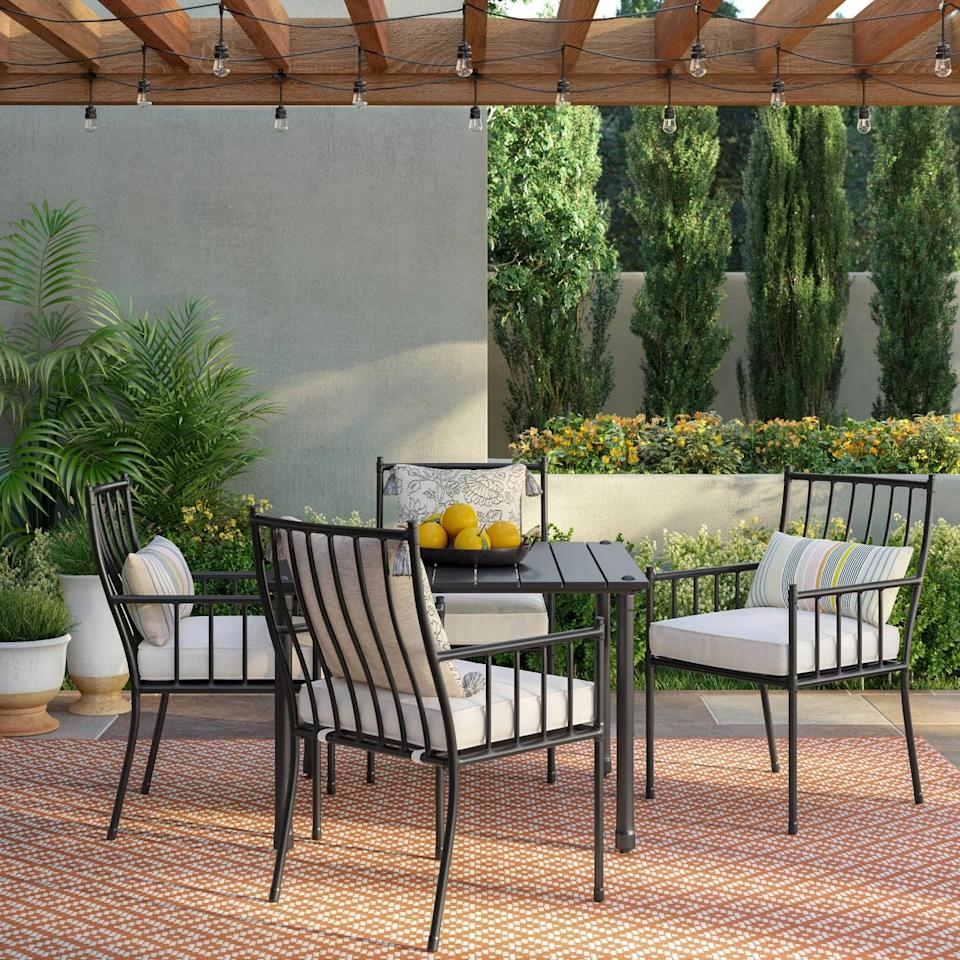 <p>The comfortable seat cushions on the <span>Fernhill Patio Dining Set</span> ($760) will have you relaxing all night long.</p>