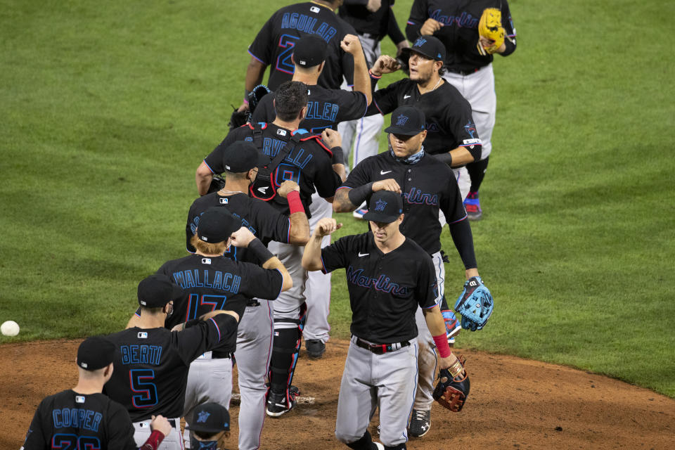PHILADELPHIA, PA - JULY 24: The Miami Marlins celebrate their Opening Day win against the Philadelphia Phillies at Citizens Bank Park on July 24, 2020 in Philadelphia, Pennsylvania. The 2020 season had been postponed since March due to the COVID-19 pandemic. The Marlins defeated the Phillies 5-2. (Photo by Mitchell Leff/Getty Images)