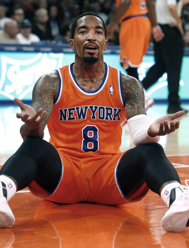 New York Knicks' J.R. Smith (8) reacts after being called for a foul against the Atlanta Hawks during the first half of an NBA basketball game Saturday, Nov. 16, 2013, in New York. Atlanta defeated New York 110-90. (AP Photo/Jason DeCrow)