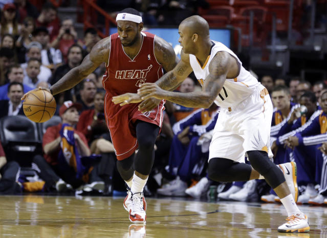 Miami Heat's LeBron James (6) dribbles after stealing the ball from Phoenix Suns' P.J. Tucker (17) during the first half of an NBA basketball game, Monday, Nov. 25, 2013, in Miami. (AP Photo/Lynne Sladky)