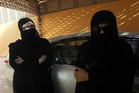 Female Saudi motorists speak to the media after driving their vehicles in defiance of the ban on driving in Riyadh