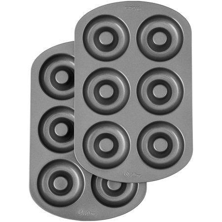 """<p><strong>Wilton</strong></p><p><a href=""""https://go.redirectingat.com?id=74968X1596630&url=https%3A%2F%2Fwww.walmart.com%2Fip%2FWilton-Non-Stick-Donut-Pans-2-Piece%2F421601243&sref=https%3A%2F%2Fwww.thepioneerwoman.com%2Fholidays-celebrations%2Fgifts%2Fg32421121%2Fkitchen-gifts%2F"""" rel=""""nofollow noopener"""" target=""""_blank"""" data-ylk=""""slk:Shop Now"""" class=""""link rapid-noclick-resp"""">Shop Now</a></p><p>A pan set like this one makes it incredibly easy to whip up a dozen baked doughnuts. </p>"""