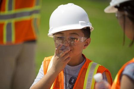 Jacob Rodriguez, 8, drinks recycled wastewater at the Edward C. Little Water Recycling Facility during the West Basin Municipal Water District's tour of a water recycling facility in El Segundo, California July 11, 2015.  REUTERS/David McNew