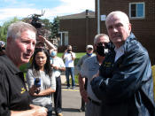Piscataway Mayor Brian Wahler, left, briefs New Jersey Gov. Phil Murphy, right, on damage to an apartment complex located along the banks of the Raritan River on Saturday Sept. 4, 2021 after the remnants of Tropical Storm Ida caused major flooding. (AP Photo/Wayne Parry)