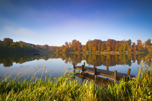 Still waters of a lake in autumn