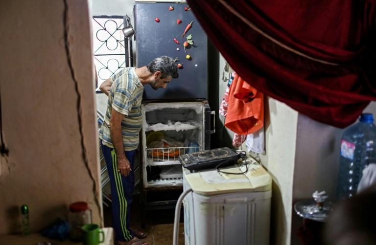 A Lebanese man looks at his empty refrigerator in the capital Beirut in a picture from June. Lebanon's economic crisis has led to a collapse of the local currency, plunging whole segments of the population into poverty