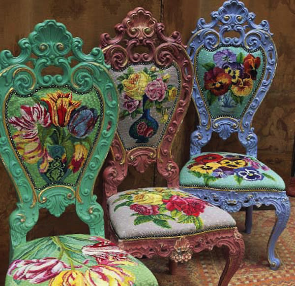 This publicity photo provided by Abrams shows three needlepoint chairs with overblown blooms by Kaffee Fassett. Fassett uses exuberant color and bold images in his embroidery, knitting and fabric designs. (AP Photo/Abrams, Brandon Mably)