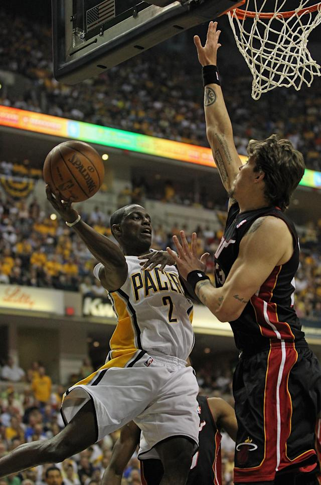 INDIANAPOLIS, IN - MAY 20: Darren Collison #2 of the Indiana Pacers leaps to pass around Mike Miller #13 of the Miami Heat in Game Four of the Eastern Conference Semifinals in the 2012 NBA Playoffs at Bankers Life Fieldhouse on May 20, 2012 in Indianapolis, Indiana. NOTE TO USER: User expressly acknowledges and agrees that, by downloading and/or using this photograph, User is consenting to the terms and conditions of the Getty Images License Agreement. (Photo by Jonathan Daniel/Getty Images)