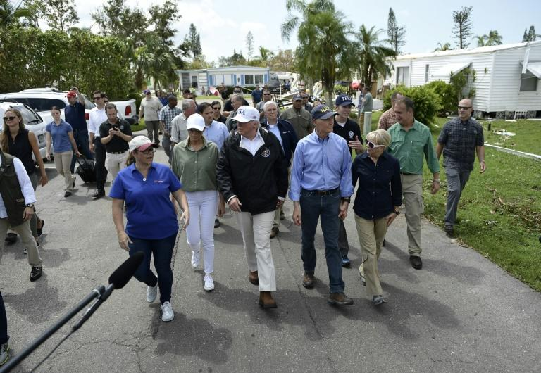President Donald Trump tours a flood-damaged neighborhood in Naples, Florida
