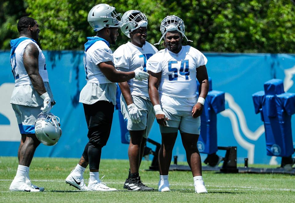 Detroit Lions defensive tackle Alim McNeill (54) and defensive tackle Levi Onwuzurike (75) during organized team activity at Lions headquarters in Allen Park, Thursday, May 27, 2021.