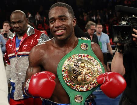 FILE PHOTO: Boxer Adrien Broner from Cincinnati, Ohio celebrates after defeating Gavin Rees from Newport, Wales during their WBC Lightweight title bout in Atlantic City, New Jersey, in this file photo taken February 17, 2013. REUTERS/Tim Shaffer/Files Picture Supplied by Action Images