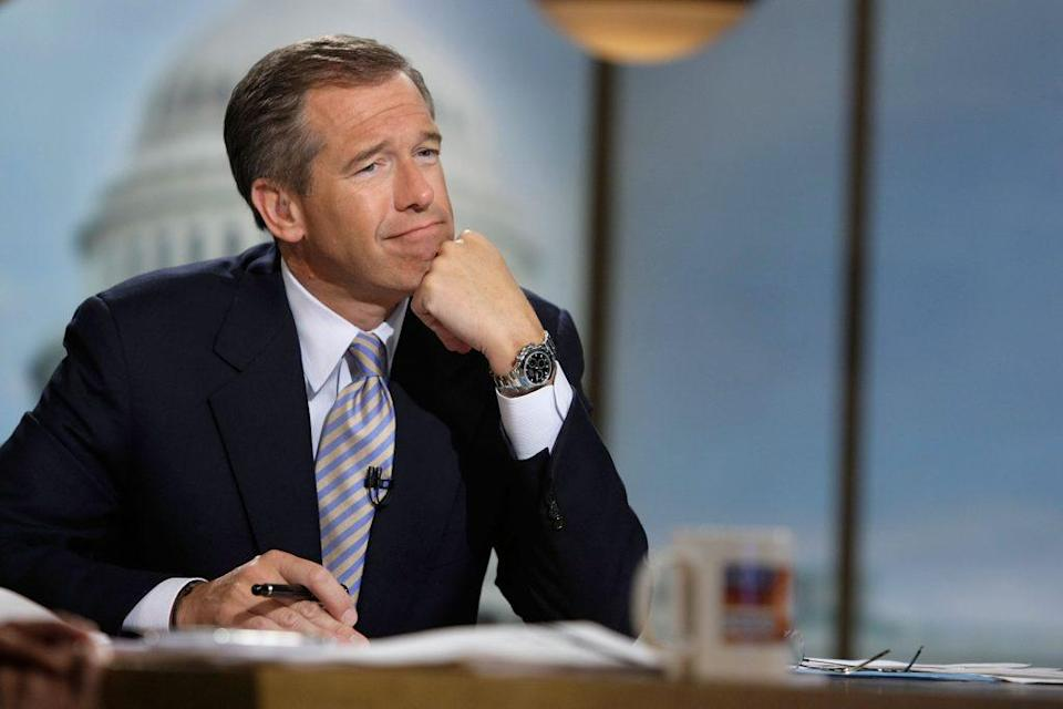 "Moderator Brian Williams watches a video which pays tribute to late moderator Tim Russert during a taping of ""Meet the Press"" at the NBC studios June 22, 2008 in Washington, DC. Williams announced that former Nightly News anchor Tom Brokaw would temporarily host the show through the presidential elections in November, 2008. (Photo by Alex Wong/Getty Images for Meet the Press)"