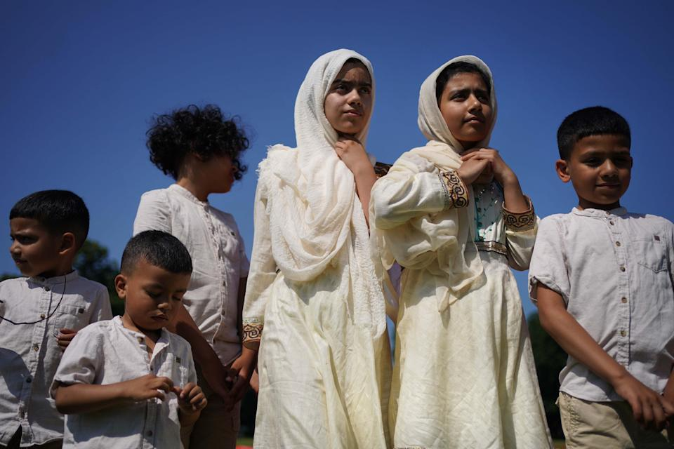 Children (consent given) at morning prayer during Eid al-Adha, or Festival of Sacrifice, in Southall Park, Uxbridge (VIctoria Jones/PA) (PA Media)