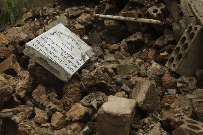 CORRECTS TO CAPITAL'S ONLY JEWISH CEMETERY, NOT COUNTRY'S - Graves in a Jewish cemetery lie damaged from heavy rains in the Sodeco area of Beirut, Lebanon, Thursday, Dec. 26, 2019. A heavy storm hit Lebanon with heavy rain and strong winds causing an old wall to collapse in the capital's only Jewish cemetery, causing damage to several tombstones. Lebanon once had a thriving Jewish community, but the various Arab-Israeli wars and Lebanon's own 1975-90 civil war caused waves of emigration and almost none are left in the country today. (AP Photo/Hassan Ammar)