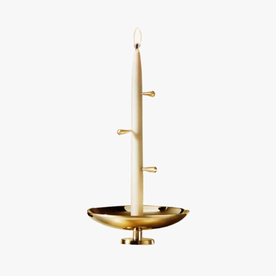 """Turn morning meditations into a ritual with this set, which includes candles and brass pins that fall with a calming ding to mark the end of your practice. $175, 3RD RITUAL. <a href=""""https://3rdritual.com/product/bel/"""" rel=""""nofollow noopener"""" target=""""_blank"""" data-ylk=""""slk:Get it now!"""" class=""""link rapid-noclick-resp"""">Get it now!</a>"""